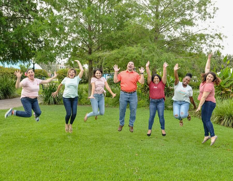 The entire Stuart Pediatric Dentistry team jumping outside